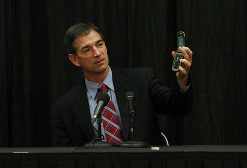Francisco Kjolseth     The Salt Lake Tribune Former Utah Jazz player John Stockton demonstrates his lack of tech savviness by pulling out his clam shell phone following a question about Twitter as he holds a press conference at Energy Solutions Arena to promote his new book on Friday, Nov. 15, 2013.