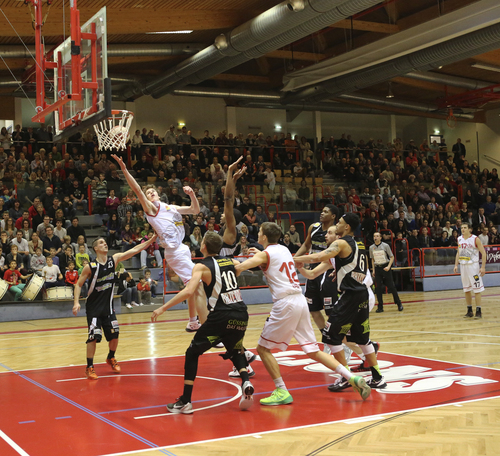 Jakob Poeltl takes the ball to the hoop in a recent game for the Arkadia Traiskirchen Lions. Poeltl, a 7-foot Austrian center, signed with Utah men's basketball on Friday, adding size to the Utes' already heralded class.  Courtesy  |  Arkadia Traiskirchen Lions