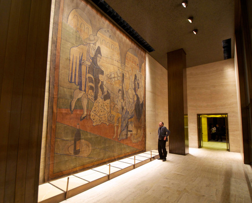 In this Feb. 28, 2014 photo provided by the New York Landmarks Conservancy, a stage curtain painted by Pablo Picasso hangs on a wall at the Four Seasons restaurant in New York. Plans to move the 1919 canvas from the Four Seasons has touched off a dispute between a prominent preservation group against an art-loving real estate magnate. (AP Photo/New York Landmarks Conservancy, Rick Bruner)