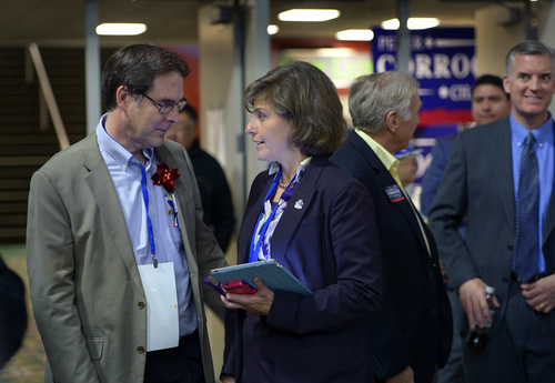 Scott Sommerdorf   |  The Salt Lake Tribune 1st Congressional District Democratic nominee Donna McAleer speaks with Richard Davis, left, about the need for a second ballot to avoid a primary with Peter Clemens at the Utah Democratic Convention, Saturday, April 26, 2014. Peter Corroon, who beat Davis in the chairman's race, is at right.