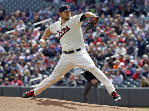 Minnesota Twins pitcher Phil Hughes delivers to the Detroit Tigers during the first inning of a baseball game in Minneapolis, Saturday, April 26, 2014. (AP Photo/Ann Heisenfelt)