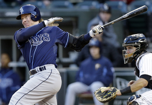 Tampa Bay Rays' Ryan Hanigan, left, hits a double against the Chicago White Sox during the fourth inning of a baseball game in Chicago, Saturday, April 26, 2014. (AP Photo/Nam Y. Huh)