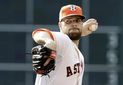 Houston Astros' Dallas Keuchel pitches against the Oakland Athletics in the first inning of a baseball game on Saturday, April 26, 2014, in Houston. (AP Photo/Pat Sullivan)
