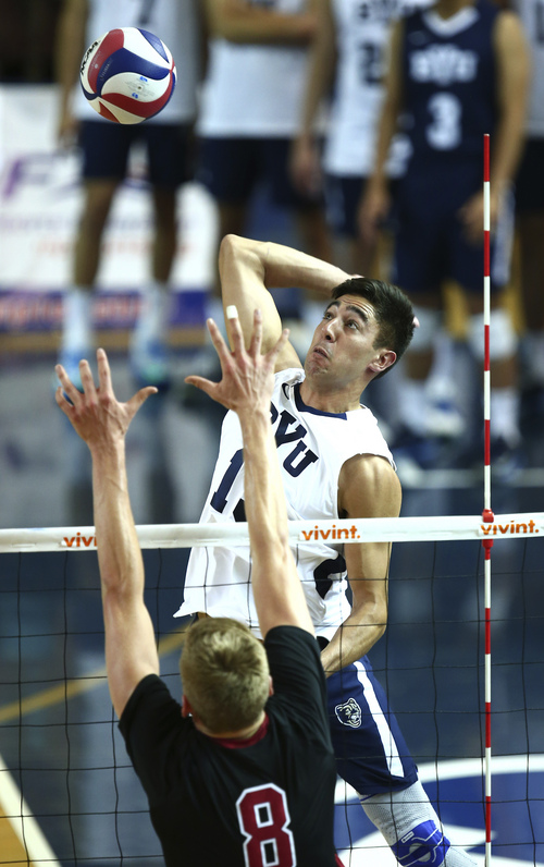 (Jaren Wilkey  |  Courtesy BYU) BYU's Taylor Sander spikes the ball past Stanford's James Shaw. BYU defeated Stanford 3-0 in the Finals of the MPSF Men's Volleyball Championships hosted by Brigham Young University in Provo on Saturday, April 26, 2014.