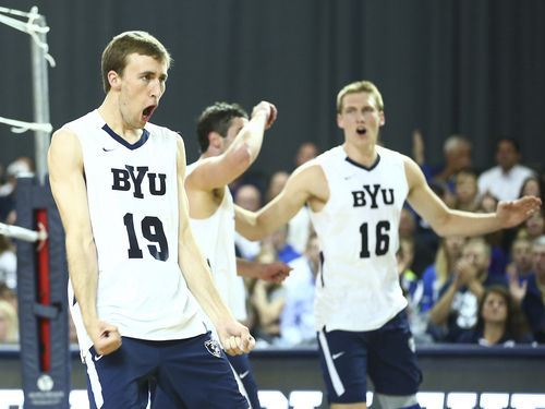 (Jaren Wilkey  |  Courtesy BYU)   BYU's (19) Devin Young celebrates a block against Stanford. BYU defeated Stanford 3-0 in the Finals of the MPSF Men's Volleyball Championships hosted by Brigham Young University in Provo on Saturday, April 26, 2014.