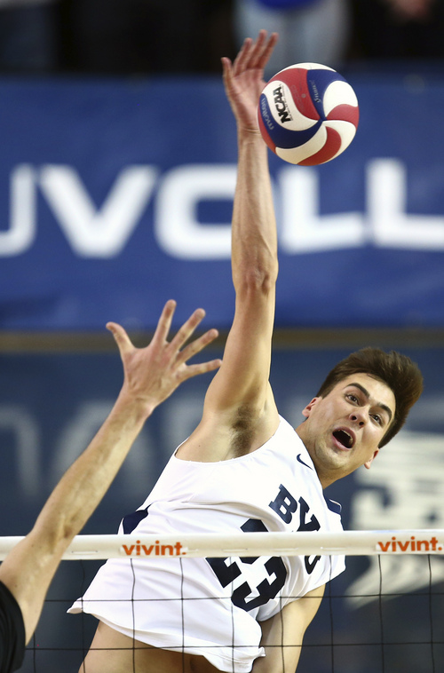 (Jaren Wilkey |  Courtesy BYU) BYU's Michael Hatch spikes the ball against Stanford. BYU defeated Stanford 3-0 in the Finals of the MPSF Men's Volleyball Championships hosted by Brigham Young University in Provo on Saturday, April 26, 2014.