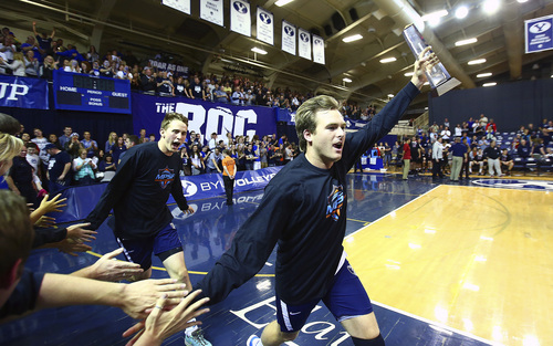 (Jaren Wilkey  |  Courtesy BYU) BYU's Hamilton Day carries the MPSF Championship trophy while he celebrates with fans in the Smith Fieldhouse on Saturday, April 26, 2014. BYU defeated Stanford 3-0 in the Finals of the MPSF Men's Volleyball Championships hosted by Brigham Young University in Provo.