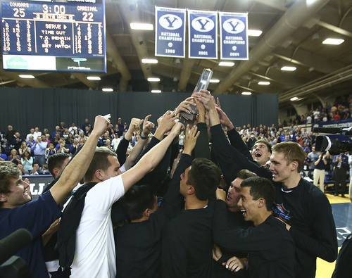(Jaren Wilkey  |  Courtesy BYU)  The BYU Men's Volleyball team celebrates its second consecutive MPSF Conference Championship with a win over Stanford on Saturday, April 26, 2014. BYU defeated Stanford 3-0 in the Finals of the MPSF Men's Volleyball Championships hosted by Brigham Young University in Provo.