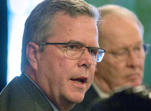 """FILE - This March 19, 2014 file photo shows former Florida Gov. Jeb Bush speaking at an education forum in Nashville, Tenn.  Battling """"the soft bigotry of low expectations"""" with national education goals was former Republican President George W. Bush's campaign mantra. But many of his party's would-be successors are calling for just the opposite of government-set rules, splitting the party over education policy as the GOP class of 2016 presidential hopefuls takes shape. Jeb Bush, who supports a national education policy, and Rand Paul, who abhors the idea, personify the divide. Forty-four states voluntarily participate in standards developed in part by GOP governors. (AP Photos/Erik Schelzig, File)"""