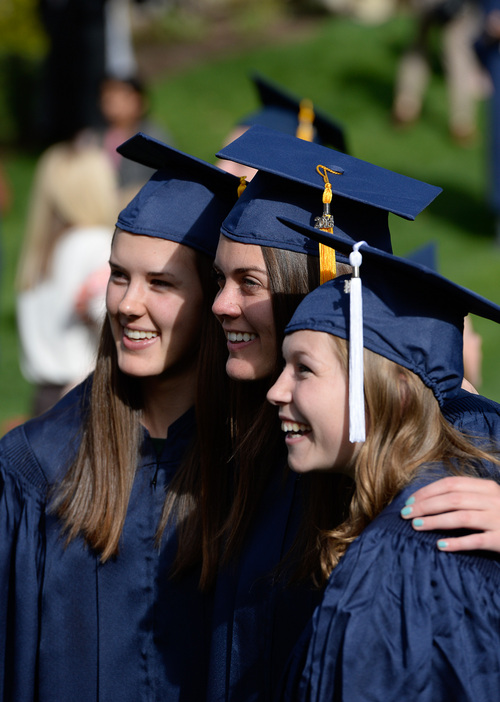 Franciso Kjolseth  |  The Salt Lake Tribune Friends Alex Wille, Annie Hulbert and Jessica Littlefield, from left, pose for photographs as the BYU class of 2014 celebrates following commencement ceremonies at the Marriott Center in Provo on Thursday, April 24, 2014.