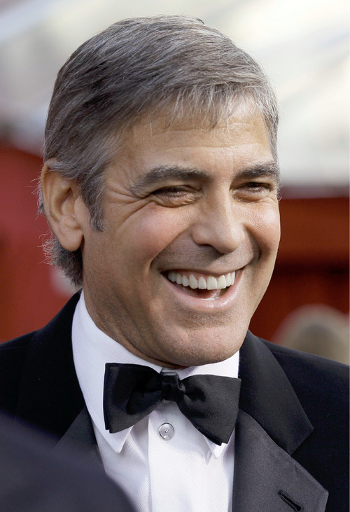 FILE - George Clooney arrives at the 82nd Academy Awards in this  March 7, 2010 file photo taken in the Hollywood section of Los Angeles. The Academy of Television Arts and Sciences announced it will present the 49-year-old actor with its Bob Hope Humanitarian Award at the Emmy ceremony next month. (AP Photo/Amy Sancetta, File)