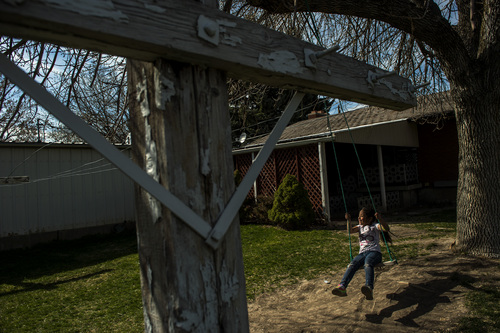 Chris Detrick  |  The Salt Lake Tribune Katy Granda, 6, plays on a swing at their home in Garland Wednesday April 16, 2014. Part of the family has been ordered to be deported to El Salvador.