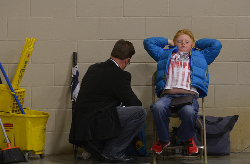 "Leah Hogsten  |  The Salt Lake Tribune ""I try to expose him to the political process,"" said Mike Owens of his son Carter, 9, from Eagle Mountain who attended the Utah Republican Party 2014 Nominating Convention at the South Towne Expo Center, Saturday, April 26, 2014."