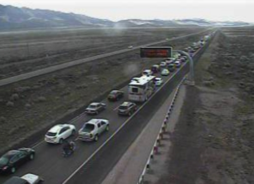(UDOT traffic camera screen grab) A reported hostage situation has closed down I-15 in central Utah, creating a massive traffic backup for motorists.