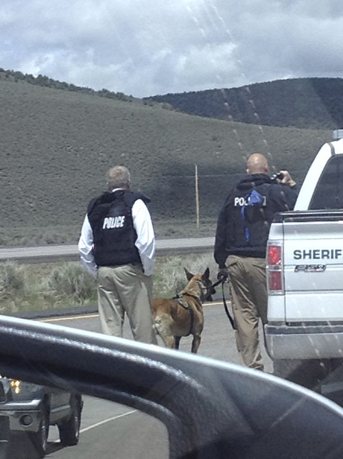 (Courtesy photo) Police respond to a hostage situation on I-15 in Iron County on Sunday. A suspect allegedly held a young child hostage, barricaded himself in a vehicle on I-15 and forced police to shut down the highway in both directions.