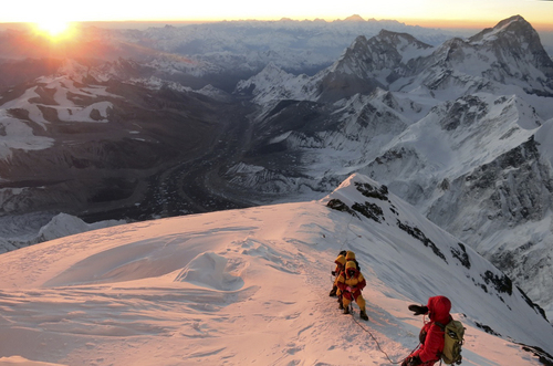 (AP Photo/Alpenglow Expeditions, Adrian Ballinger)   Climbers make their way to the summit of Mount Everest In this May 18, 2013, photo released by mountain guide Adrian Ballinger of Alpenglow Expeditions. An avalanche swept down a climbing route on Mount Everest early Friday, April 18, killing 16 Nepalese guides.