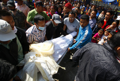 (AP Photo/Niranjan Shrestha) The body of Nepalese mountaineer Ang Kaji Sherpa, killed in an avalanche on Mount Everest, is carried to the Sherpa Monastery in Katmandu, Nepal, Saturday, April 19, 2014. An avalanche a day earlier swept over a group of Sherpa guides in the deadliest disaster on the world's highest peak.