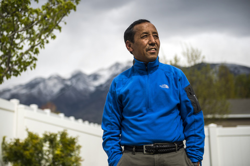 Chris Detrick  |  The Salt Lake Tribune Apa Sherpa poses for a portrait at his home in Draper Tuesday April 29, 2014. Apa Sherpa, world record holder with 21 summits of Mount Everest, is back from Nepal. He wasn't climbing, but delivering money and computers to villages in the Himlayan Highlands. While in Nepal 16 Sherpas died in an avalanche on Everest.
