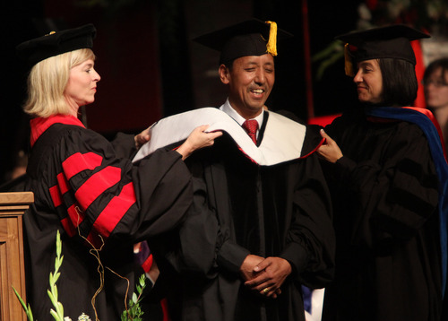 Rick Egan  | The Salt Lake Tribune  Apa Sherpa receives an honorary degree at the University of Utah's graduation ceremony at the Huntsman Center, Thursday, May 2, 2013.