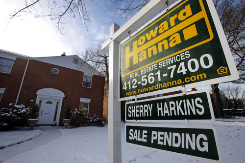 FILE - This Thursday, Jan. 9, 2014, file photo, shows a for sale sign in front of a house in Mount Lebanon, Pa.  Standard & Poor's/Case-Shiller reports on U.S. home prices in February on Tuesday, April 29, 2014. (AP Photo/Gene J. Puskar, File)