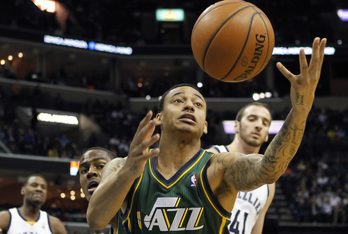 Utah Jazz guard Diante Garrett (8) tries to grab a rebound against the Memphis Grizzlies in the first half of an NBA basketball game on Wednesday, March 19, 2014, in Memphis, Tenn. (AP Photo/Lance Murphey)