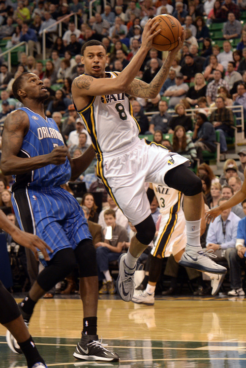 Rick Egan  | The Salt Lake Tribune   Utah Jazz guard Diante Garrett (8) flies up the middle as he looks for a team mate to pass to, in NBA action, The Utah  Jazz vs. the Orlando Magic, at EnergySolutions Arena Saturday, March 22, 2014.