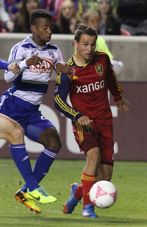 Rick Egan  | The Salt Lake Tribune   FC Dallas defender/midfielder Kellyn Acosta (23) grabs Real Salt Lake midfielder Luis Gil (21) in MLS soccer action at Rio Tinto Stadium, Saturday, October 5, 2013.