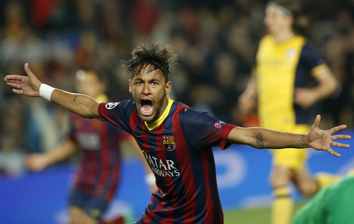 Barcelona's Neymar celebrates after scoring his sides first goal during a first leg quarterfinal Champions League soccer match between Barcelona and Atletico Madrid at the Camp Nou stadium in Barcelona, Spain, Tuesday April 1, 2014. (AP Photo/Emilio Morenatti)
