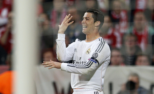 Real's Cristiano Ronaldo celebrates scoring his side's 3rd goal during the Champions League semifinal second leg soccer match between Bayern Munich and Real Madrid at the Allianz Arena in Munich, southern Germany, Tuesday, April 29, 2014. (AP Photo/Matthias Schrader)