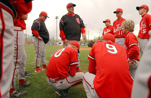 Jim Nelson, center, head baseball coach for Spanish Fork huddles with his team following a loss to Springville in 2003.      Photo by Francisco Kjolseth/The Salt Lake Tribune.