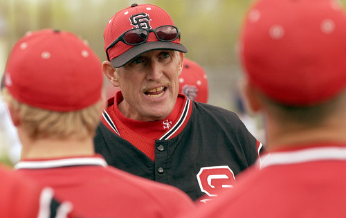 Jim Nelson, head baseball coach for Spanish Fork huddles the team following a loss to Springville in 2003.    Photo by Francisco Kjolseth/The Salt Lake Tribune.