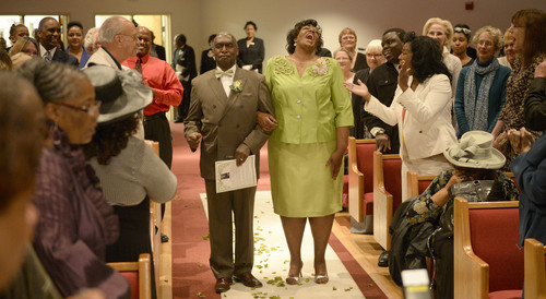 Al Hartmann  |  The Salt Lake Tribune Rev. France Davis Davis is esorted up aisle by Sister Leslie Henderson as members of the Calvary Baptist Church celebrate Pastor France Davis's  40th anniversary as pastor Sunday April 27 in Salt Lake City.
