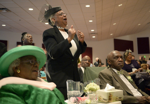 Al Hartmann  |  The Salt Lake Tribune Members of the Calvary Baptist Church celebrate in song at Pastor France Davis's 40th anniversary as their pastor Sunday April 27 in Salt Lake City.  First Lady Wiilene Davis and Rev. France Davis, bottom.