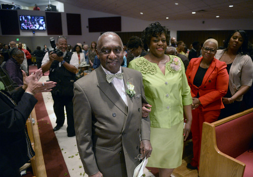 Al Hartmann  |  The Salt Lake Tribune Rev. France Davis Davis is escorted up aisle by Sister Leslie Henderson as members of the Calvary Baptist Church celebrate Pastor France Davis's  40th anniversary as pastor Sunday April 27 in Salt Lake City.