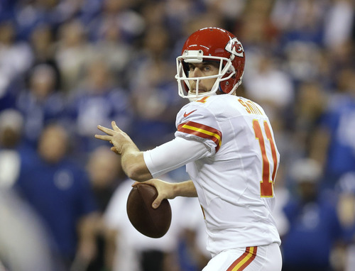 Kansas City Chiefs quarterback Alex Smith (11) passes the ball against the Indianapolis Colts during the first half of an NFL wild-card playoff football game Saturday, Jan. 4, 2014, in Indianapolis. (AP Photo/Michael Conroy)