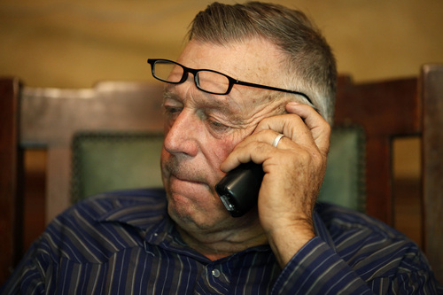 File  |  The Associated Press Cliven Bundy talks on the phone at his ranch near Bunkerville Nev.