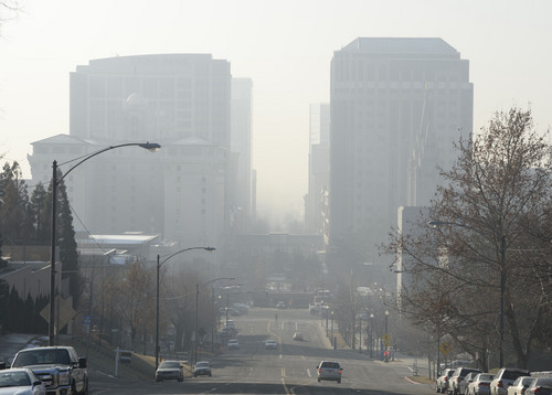 Francisco Kjolseth  |  Tribune file photo The pollution-plagued Salt Lake Valley is obscured by another red air day as they inversion continues on Wednesday, Jan. 22, 2014.
