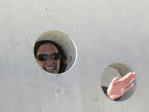 Tom Wharton | The Salt Lake Tribune  Dutch visitor Noortje van Oostrum explores Nancy Holt's Sun Tunnels in a remote corner of northwestern Utah.