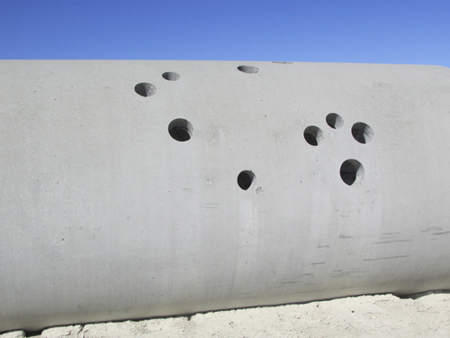 Tom Wharton | The Salt Lake Tribune  Holes cut in cement Sun Tunnels tubes resemble constellations.