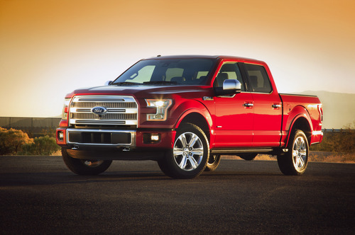 This undated photo provided by Ford shows the company's new 2015 F-150 pickup truck. On Monday, Jan. 13, 2014, Ford unveils a new F-150 built almost entirely out of aluminum. The lighter material, which shaves as much as 700 pounds off the truck, will save fuel and make the truck more nimble without sacrificing power, Ford says. (AP Photo/Ford)