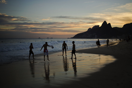 A group of men play soccer on Ipanema beach in Rio de Janeiro, Brazil, Thursday, May 1, 2014. Rio is one of the 12 host cities of the upcoming 2014 FIFAWorld Cup. With the soccer tournament only weeks away, Brazil has been struggling to get the country ready for the international sporting event. (AP Photo/Hassan Ammar)