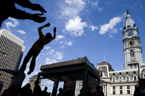 Members of Project Positive perform near City Hall Thursday, May 1, 2014, in Philadelphia. The group utilizes hip hop dance in an effort reach out to youth. (AP Photo/Matt Rourke)