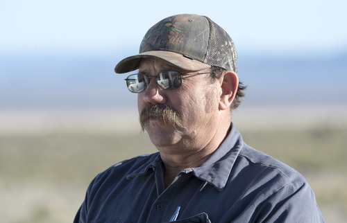 Rick Egan  |  The Salt Lake Tribune Iron County rancher Matt Wood, one of the plaintiffs in a new federal lawsuit  against the Bureau of Land Management, talks about the number of wild horses on BLM land where he grazes his cattle northwest of Cedar City, Wednesday, April 23, 2014