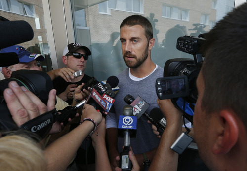 Kansas City Chiefs quarterback Alex Smith talks with reporters after moving into a dorm at Missouri Western State University for the teams NFL football training camp in St. Joseph, Mo., Monday, July 22, 2013. (AP Photo/Orlin Wagner)