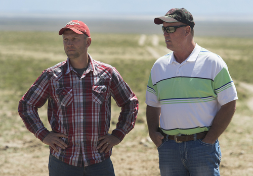 Rick Egan  |  The Salt Lake Tribune  Iron County Commissioner David Miller (left) and Beaver County Commissioner Mark Whitney (right) discuss the problems that come with wild horses grazing on public land northwest of Cedar City, Wednesday, April 23, 2014