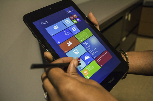 This April 24, 2014 photo shows the ASUS VivoTab Note 8 tablet computer, in Atlanta. The Note 8 runs a full version of Microsoft's Windows 8 operating system and comes with a Wacom stylus pen for use with the screen that has 1024 levels of pressure sensitivity. (AP Photo/Ron Harris)