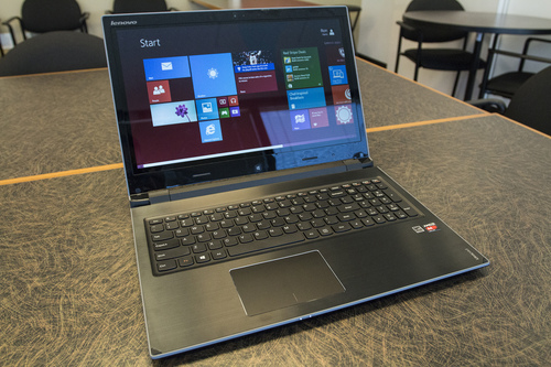 This April 25, 2014 photo shows the Lenovo Flex 15D laptop computer, in Atlanta. The Flex 15D has a touch-sensitive screen and can be positioned with the keybord facing down and act as a stand for touch screen use. (AP Photo/Ron Harris)