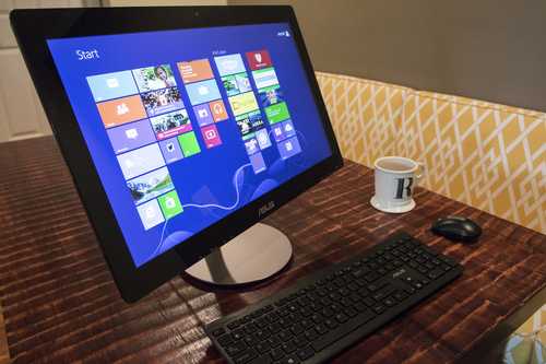 This April 24, 2014 photo shows the ASUS All-in-One PC ET2322 desktop computer, in Decatur, Ga. The computer has a touch-sensitive, 23-inch display. (AP Photo/Ron Harris)