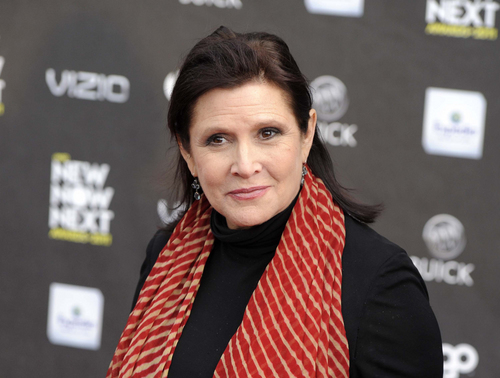 """FILE - This April 7, 2011 file photo shows Carrie Fisher at the 2011 NewNowNext Awards in Los Angeles. After months of carefully guarded secrecy and endless Internet speculation, the cast of the latest incarnation of the space epic,  """"Star Wars: Episode VII,"""" was unveiled Tuesday, April 29, 2014, on the official """"Star Wars"""" website by Lucasfilm and the Walt Disney Co. The """"Episode VII"""" cast is a mix of fresh faces, up-and-comers and established names, including veterans Harrison Ford, Mark Hamill and Fisher. (AP Photo/Chris Pizzello, file)"""
