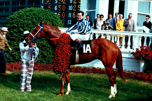 Secretariat and jockey Ron Turcotte pose in the winner's circle after winning the 1973 Kentucky Derby at Churchill Downs in Louisville, Ky., on May 5, 1973.  Secretariat won the 99th Run for the Roses in a record 1:59 2/5, becoming the first horse to complete the 1 1/4-mile course for the Kentucky Derby in less than two minutes.  Holding on at left is groom Ed Sweet.  (AP Photo)